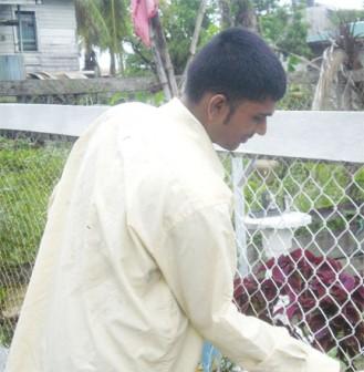 Vishal painting his fence