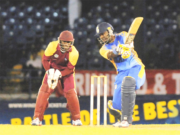 Barbados skipper Dwayne Smith belts a delivery from Justin Athanaze, not in picture for another boundary. (Photo courtesy WICB media)