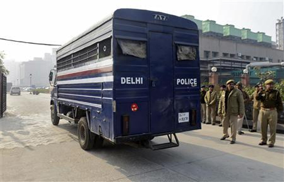 A police van carrying five men accused of the gang rape and murder of an Indian student arrives at a court in New Delhi January 7, 2013. (Reuters/Stringer)
