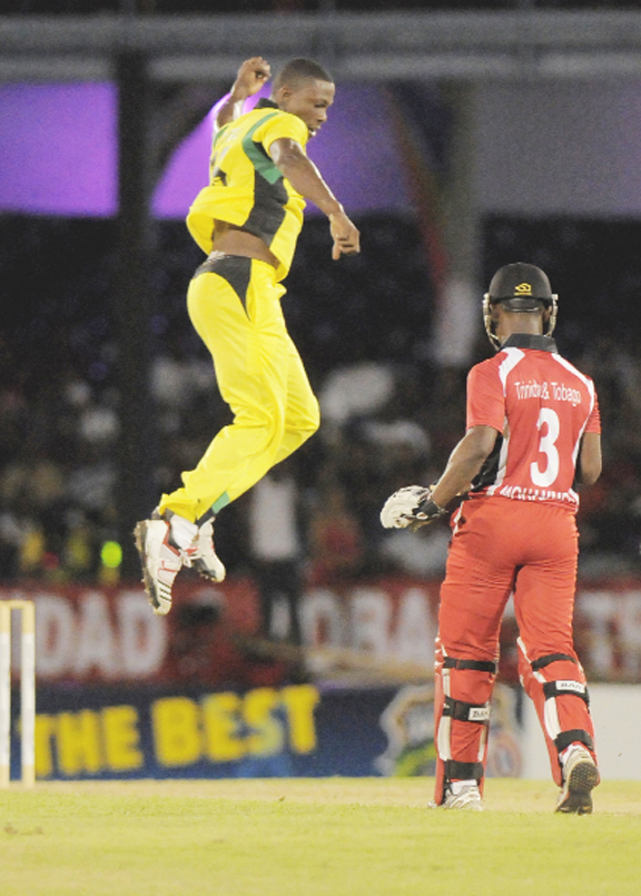 Jamaica's Sheldon Cotterell jumps for joy after his dismissal of Trinidad's Jason Mohammed. (photo courtesy of WICB Media)