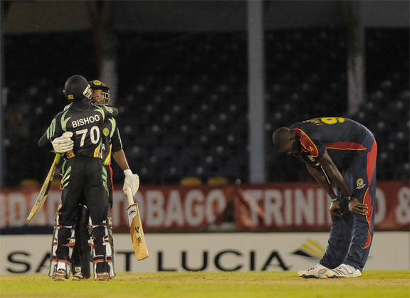 This  picture tells it all, the agony of defeat and the unbridled joy of victory. At left, Guyana's ninth wicket pair of skipper Veerasammy Permaul and Devendra Bishoo celebrates the stunning last over victory while at right fast bowler Jason Holder is despondent, left to rue what might have been. (Photo courtesy of WICB media)