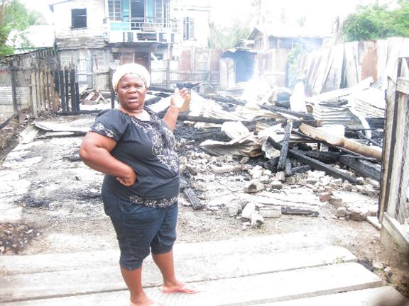 Debra David points to the destruction