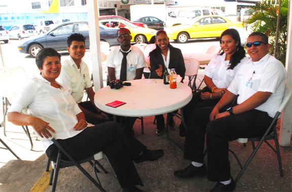 Annette Arjoon-Martins (left) with trainees at ASL's Flight School and other staffers at the company's Ogle Complex