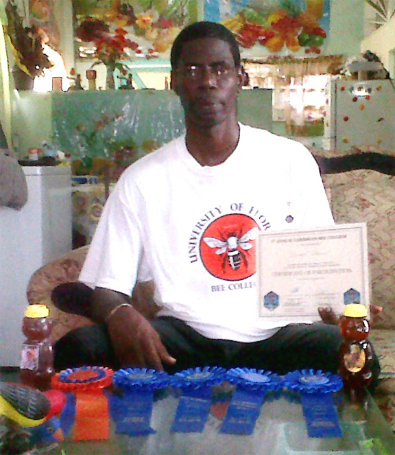 Linden Stewart with his awards from the recent Honey Fair in Grenada