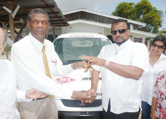 General Secretary of the Universal Peace Federation, Rev. Ronald Mc Garrell  (left) receives the keys to the bus from Roshan Khan (CEO/Founder) of RK's Group Guyana