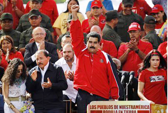 Venezuelan vice president Nicolas Maduro (C) attends a rally in support of President Hugo Chavez in Caracas yesterday. (REUTERS/ Carlos Garcia Rawlins)