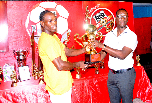 Devon Forde receives his Most Valuable Player award from GFA vice president Mark Phillips. (Aubrey Crawford photo)