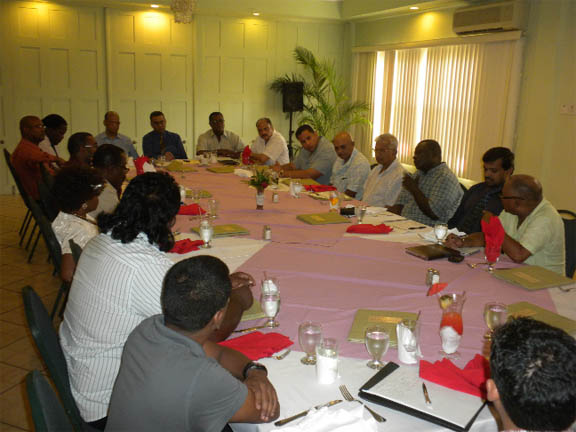Ministers Clement Rohee, Robert persaud and Bheri Ramsaran (seated at the head of table) with members of the GGDMA and others at a stakeholders' luncheon on Wednesday.