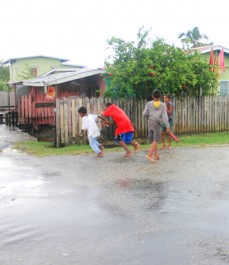 Zeelugt youths enjoying a spirited game of catch ya in the rain