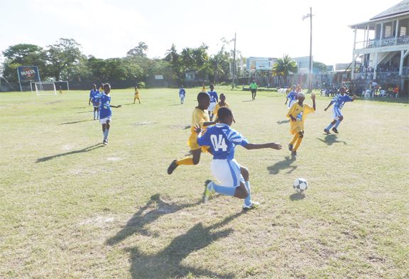 Action between Uitvlugt and BV Primary Schools on Saturday in the Chico U13 football competition at the GFC ground.