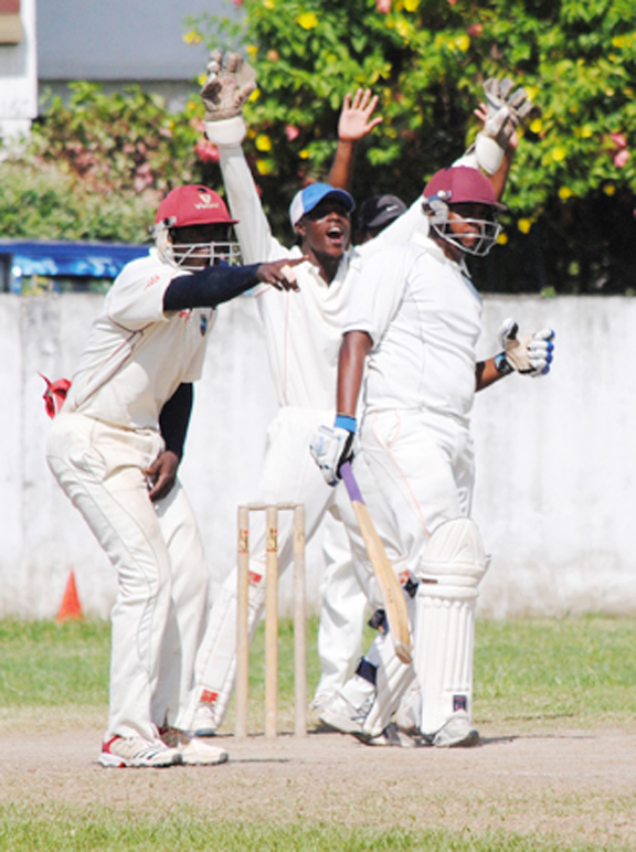 Berbice wicketkeeper Jason Sinclair and a close-in appeal for a lbw decision against a President's XI batsman. (Aubrey Crawford photo)