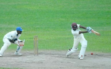 Rajendra Chandrika drives through the off-side on his way to an unbeaten 52 in Demerara's first innings score of 107-1 against the President's XI yesterday. (Orlando Charles photo)