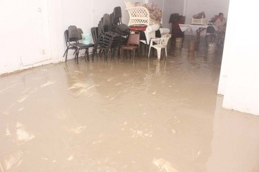 Flood aftermath: The flooded, muddied interior of the Ocean View Hotel yesterday.