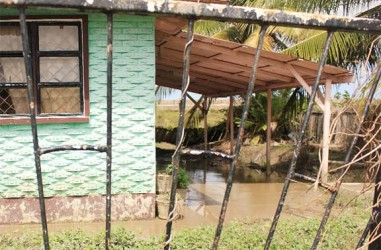 A home in Cornelia Ida still flooded yesterday, two days after the overtopping of the sea defences by unusually high tides. (Photo by Arian Browne)