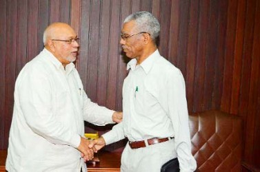 President Donald Ramotar (left) greeting Opposition Leader David Granger yesterday at the Office of the President. (GINA photo)