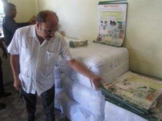 Health Minister Dr Bheri Ramsaran inspecting some of the educational material. (GINA photo)