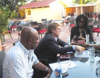 Guyana Goldfields Chief Executive Officer Patrick Sheridan (centre); Country Manager Violet Smith (right) and Human Resources Manager Peter Benny (left) during the interview.