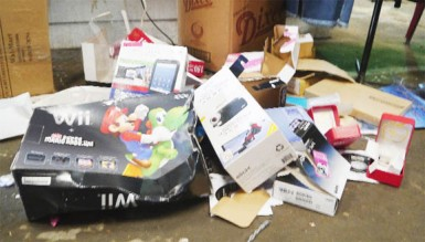 Empty gadget boxes dumped outside Jacqueline Rose's stall