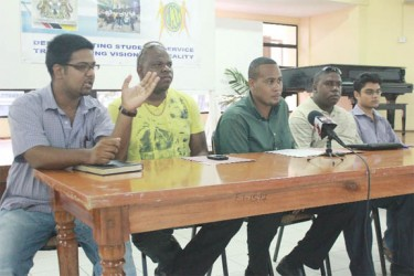 Coordinator of the UGSS Marvin Wray (centre) with other members of the UGSS at yesterday's press conference.