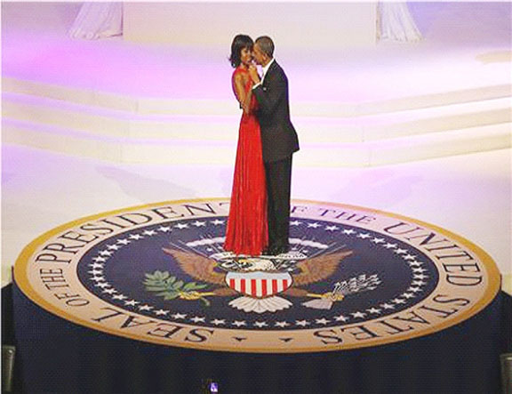 "US first lady Michelle Obama, wearing a Jason Wu dress, dances with US President Barack Obama to Jennifer Hudson singing ""Let's Stay Together"" at the Commander in Chief's ball in Washington, January 21, 2013. (Reuters/Brian Snyder)"