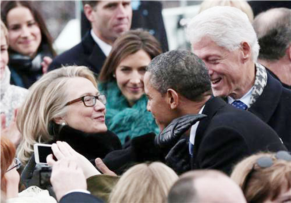 President Barack Obama greets former President Clinton and Secretary of State Hillary Clinton at the presidential inauguration in Washington. (Reuters/Win McNamee/Pool)
