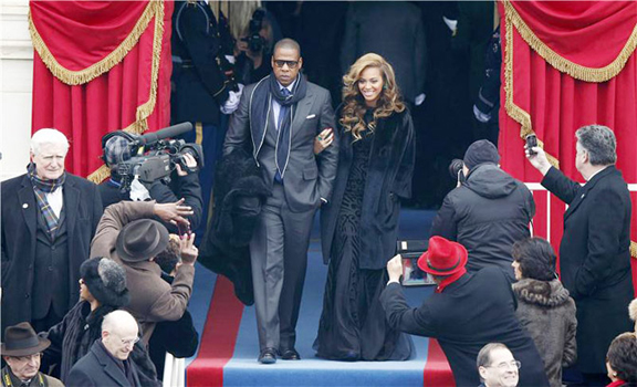 Recording artists Beyonce (R) and Jay-Z arrive ahead of the swearing-in ceremonies for US President Barack Obama on the West Front of the US Capitol in Washington, January 21, 2013. (Reuters/Jason Reed)