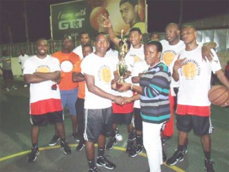 Ravens Basketball team receiving the winning trophy compliments of the Trophy Stall.