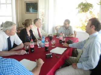 The Panthera delegation meeting with Minister Robert Persaud (at head of table)