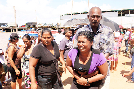 Christopher Ramnarine's mother inconsolable after seeing his body.