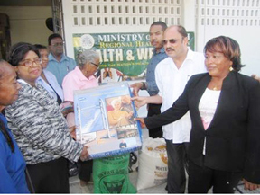 Minister of Health Dr Bheri Ramsaran (second from right) at the handing over of the wheelchairs  and walking aids to Chairperson of the Welfare Sub-committee of Periwinkle Cancer Club, Nurse Penelope Layne (second from left). Medex Zetta Albert is at right. (GINA photo)