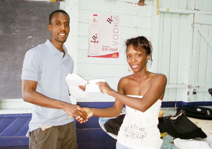 Leon Belony collecting his prize from Prudence Edwards.