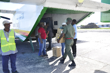 Corporal Odwin Bouyea of the Guyana Defence Force  Medical Corps helps to load supplies onto the GDF Skyvan (GINA photo)