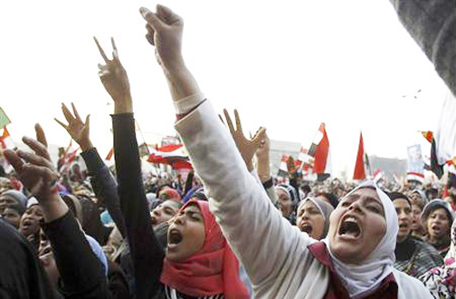 Women shout during a protest in Tahrir Square in Cairo January 25, 2013. Egypt marks the second anniversary of the uprising that swept Hosni Mubarak from power with little to celebrate. Deeply divided and facing an economic crisis, the nation is bracing for more protests, but this time against a freely elected leader. (REUTERS/Mohamed Abd El Ghany)