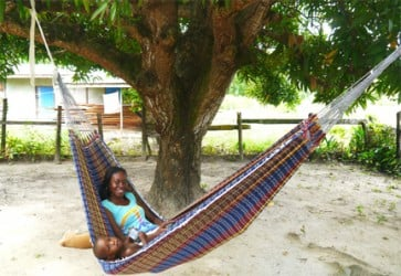 Nicketa Thomas and her baby relaxing in their hammock