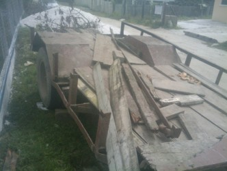 The wrecked trailer outside the Grove Police Station