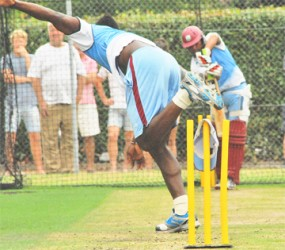 Fast bowler Andre Russell bowls to West Indies middle order batsman Ramnaresh Sarwan in the nets yesterday as the West Indies team prepares for its opening game against the Prime Minister's XI led by Ricky Ponting today. (Photo courtesy of WICB media)