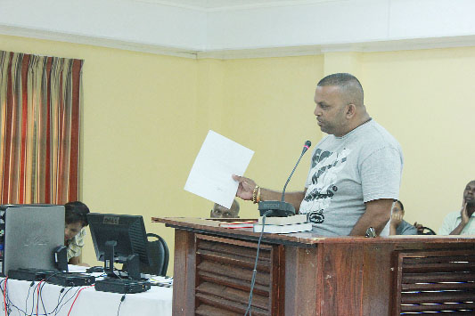 Businessman Narindra Lachman testifying at the COI