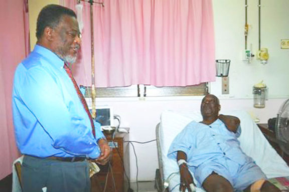On the mend: Prime Minister Samuel Hinds, performing the functions of president, chatting with People's National Congress Reform  General Secretary Oscar Clarke at the Georgetown Public Hospital Corporation (GPHC). Clarke was shot on Tuesday during a home invasion at his Plum Park, Sophia home. (GINA photo)