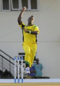 Fast bowler Andre Russell sends down another delivery during his haul of four for 22. (Photo courtesy WICB)
