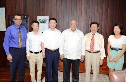 The Bai Shan Lin Forest Development Inc team with President Donald Ramotar (third from right) and Minister of Natural Resources and the Environment Robert Persaud (left) (GINA photo)