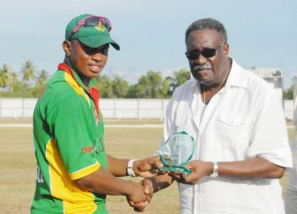 Guyana's Chris Barnwell receives his man of the Match award from ICC's Clive Lloyd in 2011 (SN file photo)