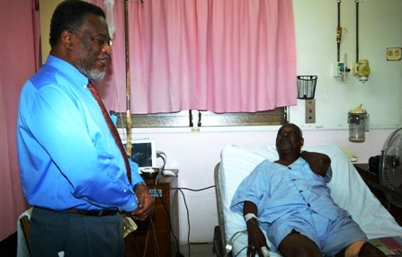 Prime Minister Sam Hinds and Oscar Clarke speaking today at the Georgetown Public Hospital. (GINA photo)