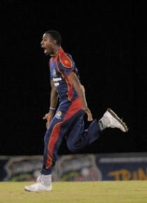 Derone Davis celebrates his hat-trick on Friday night. (Photo courtesy WICB)