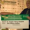 Managing Director of GENEQUIP, Renger van Dijk (left) handing over the cheques to Christopher Fernandes.