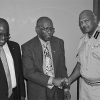 Minister of National Security Jack Warner, centre, congratulates new Chief Fire Officer Naya Rampersad. The outgoing Fire Chief Carl Williams is at left. (Trinidad Guardian photo)