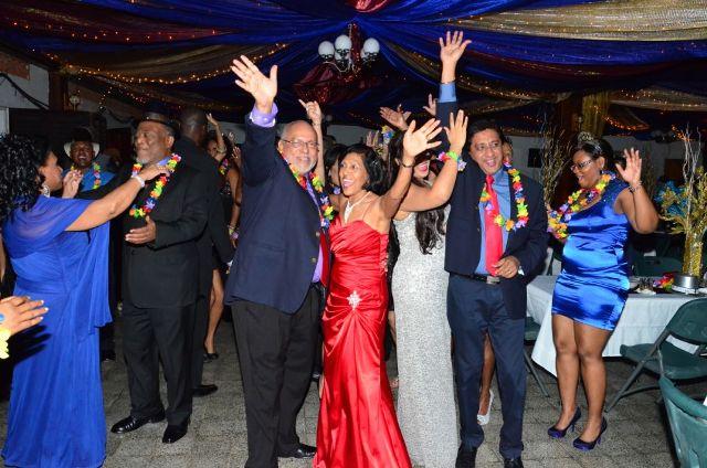 President Donald Ramotar and First Lady Deolatchmee Ramotar ringing in the New Year at Camp Ayanganna. (GINA photo)