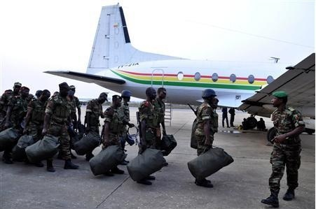 Benin soldiers stand in preparation to leave for their deployment to Mali, in the capital Cotonou January 18, 2013. The contingent of around 30 Benin troops will leave Cotonou for the Mali capital Bamako.  Credit: Reuters/Charles Placide