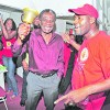 Orville London rings a bell as he celebrates victory in yesterday's Tobago House of Assembly (THA) elections at the party's Scarborough headquarters. London has secured a fourth term as THA Chief Secretary.