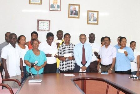 Minister Leslie Ramsammy (at centre with necktie) poses with the groups and officials of his ministry and IPED. (Ministry of Agriculture photo)