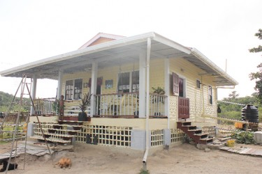 One of the two houses built by GuySuCo following a report in this newspaper in 2010 about the inhabitable conditions under which the workers lived. The house is occupied by Regan Harris, who heads the three member team on the compound, and his family. (Arian Browne photo)